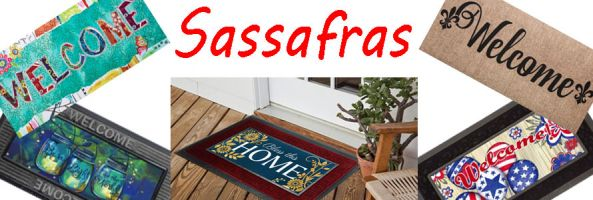 This image features five Sassafras: Wonderfully Quirky Welcome, Burlap Welcome, Patriotic Ballons, Bless this Home and Be A Light either as stand alone mats or in their trays.